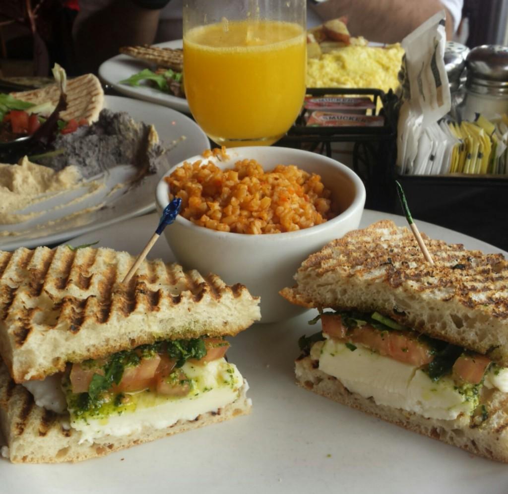 Caprese sandwich, wheat bulgur and a mimosa