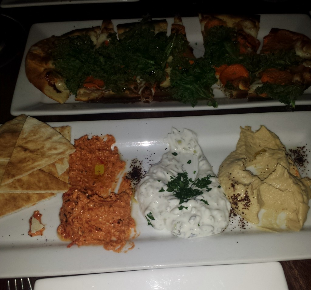 Front: Dips and pita. Back: Kale and sweet potato flatbread