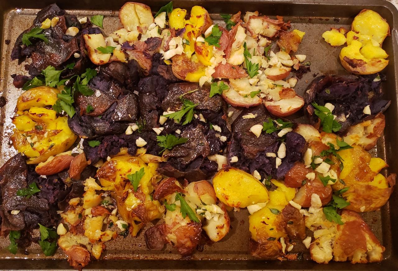 Crispy smashed potatoes on baking sheet